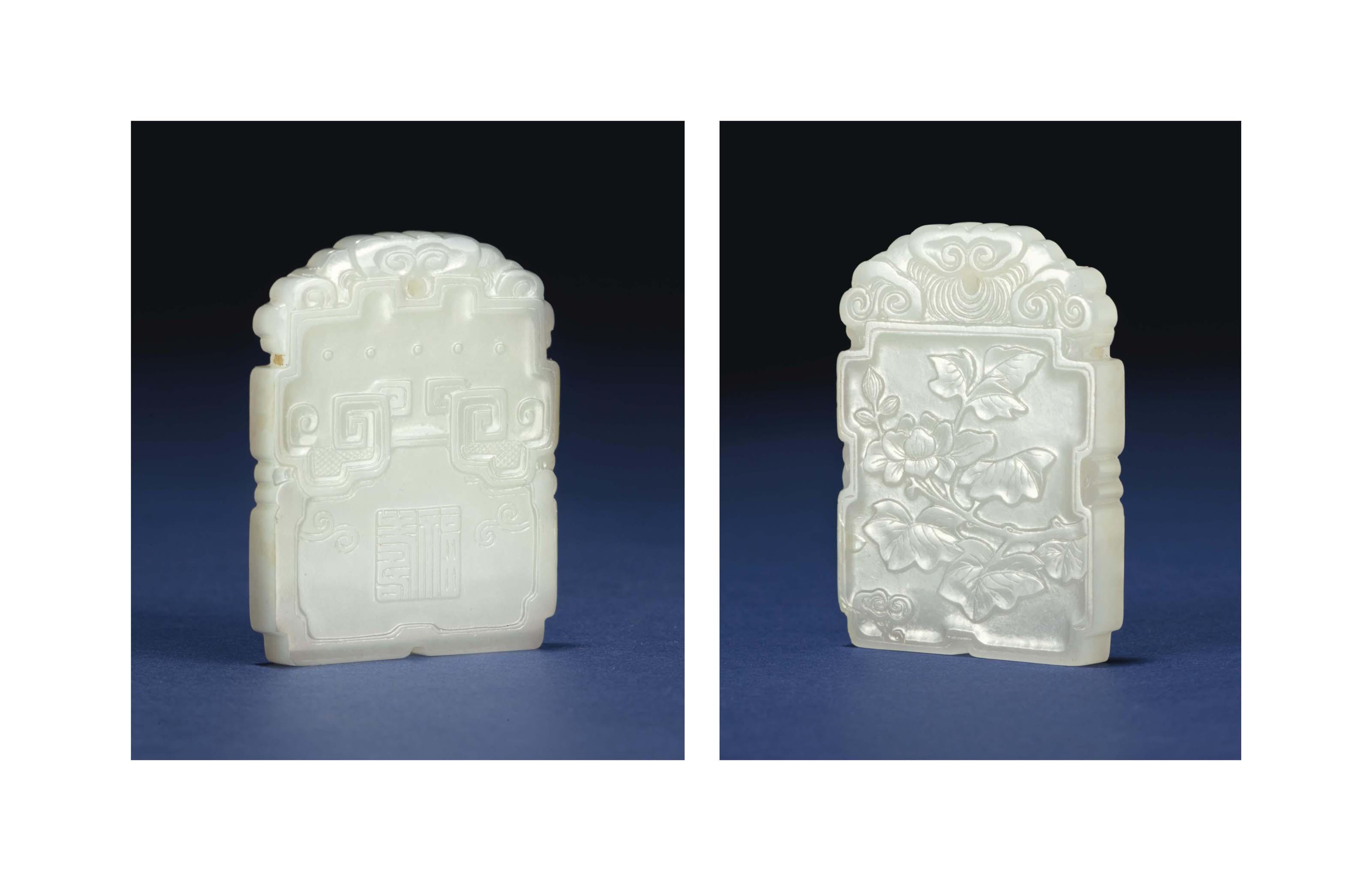 A WHITE JADE SHAPED PENDANT