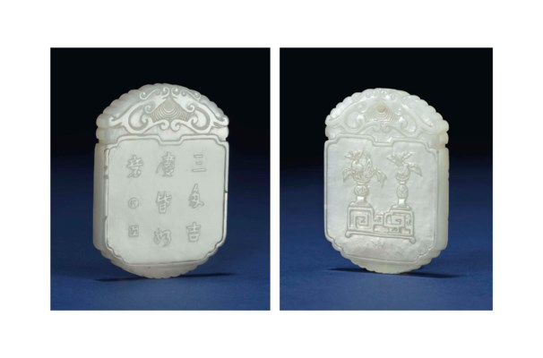 A WHITE JADE SHAPED PENDANT PL