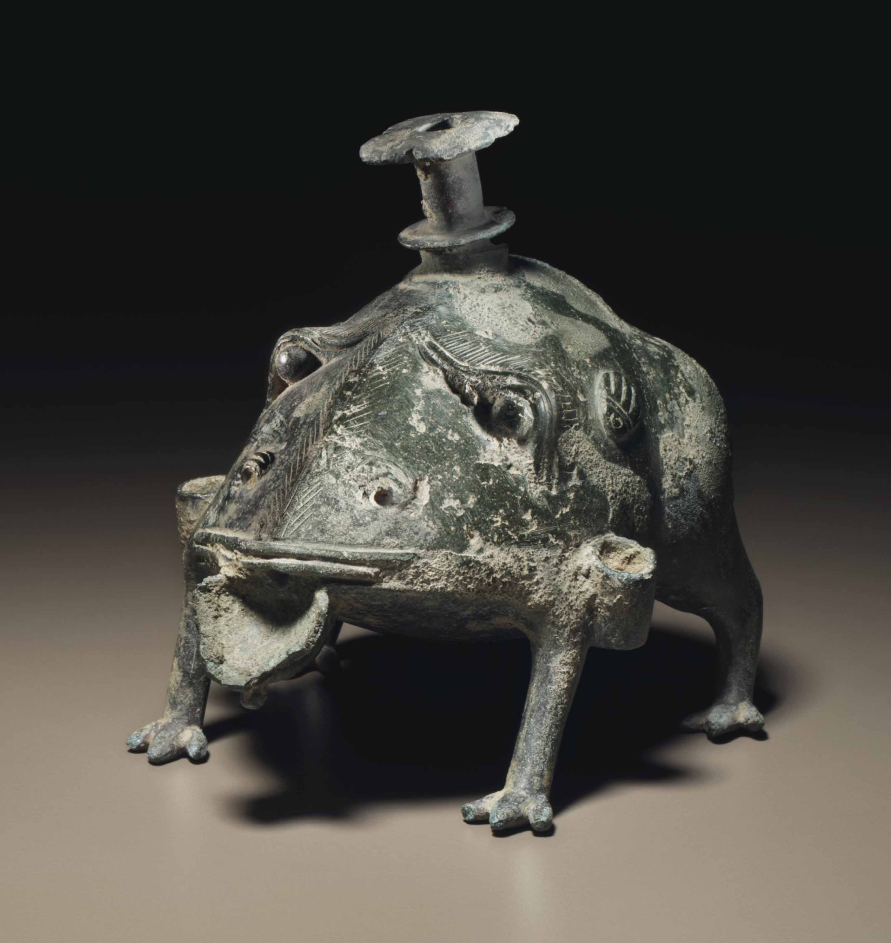 A RARE FROG-FORM WATER POT AND