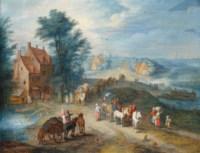 Une rue de village avec des voyageurs