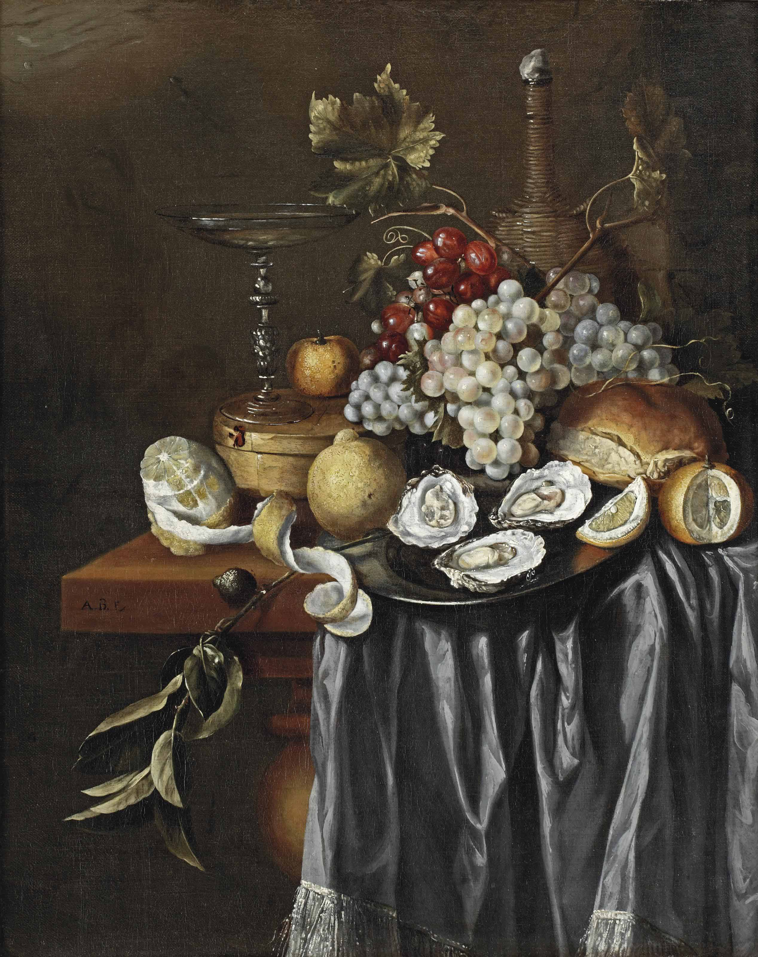 A peeled lemon, a Venetian glass, a clementine, blue and white grapes, lemons, oysters on a pewter plate, and a jug, all on a partially draped table