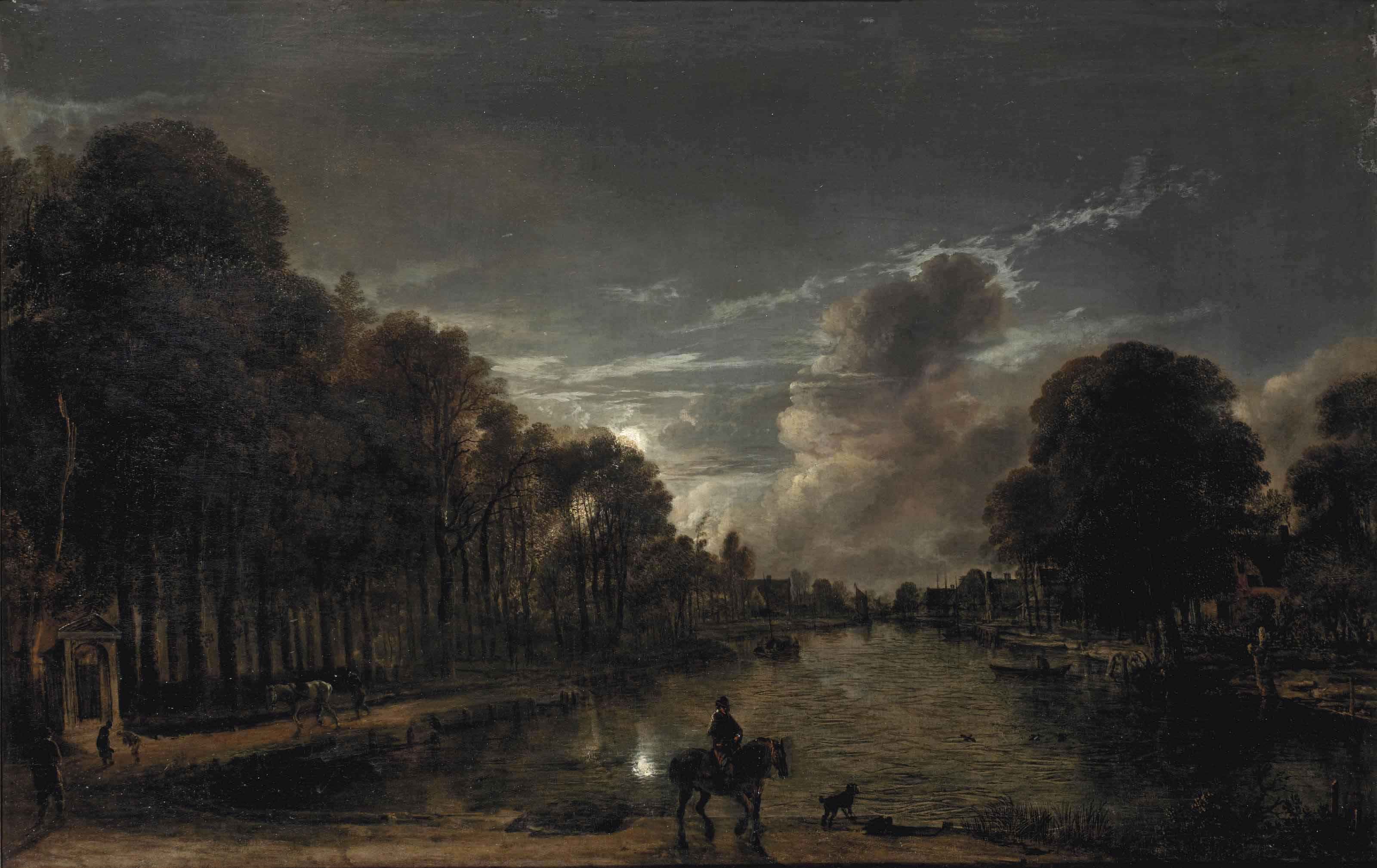A moonlit wooded landscape with a horseman and other figures by a canal, a town beyond