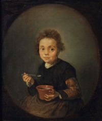 Portrait of a little girl eating porridge, in a feigned oval