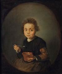 Portrait of a little girl eating porridge, in a feigned oval