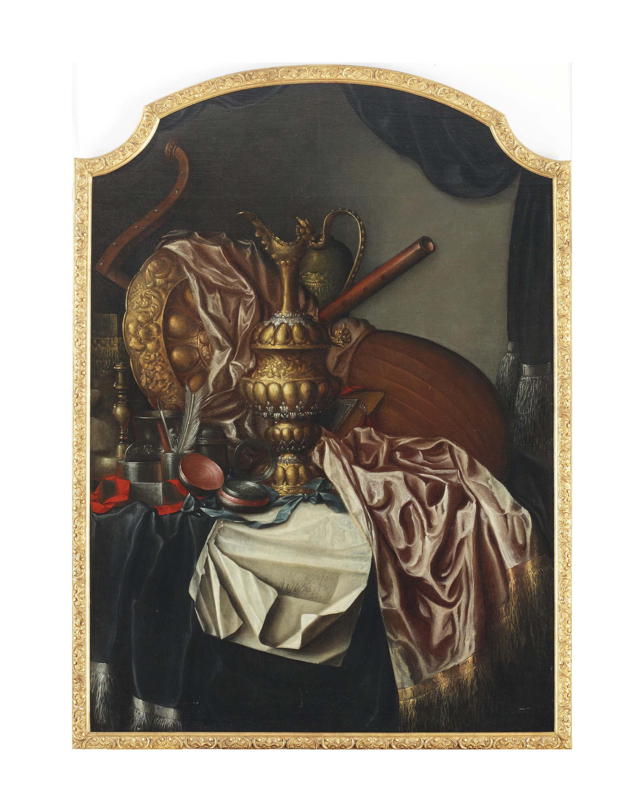 A brass urn, a brass shield, musical instruments, a quill, a compass, a red and a green ribbon, a manuscript and other objects, all on a draped table