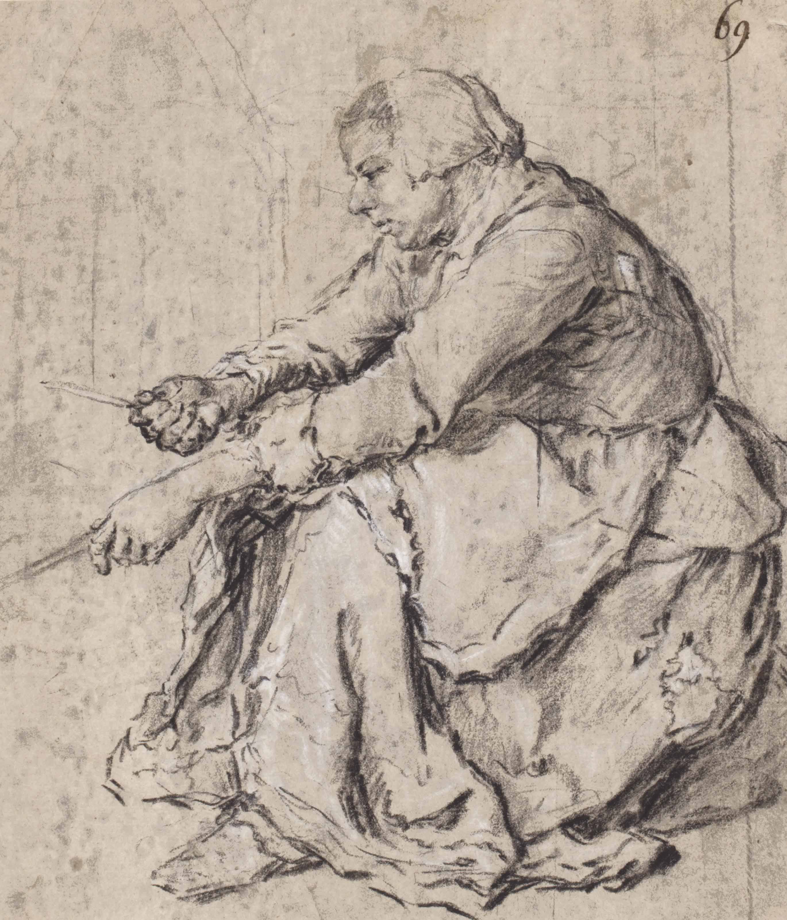 A seated woman making pancakes