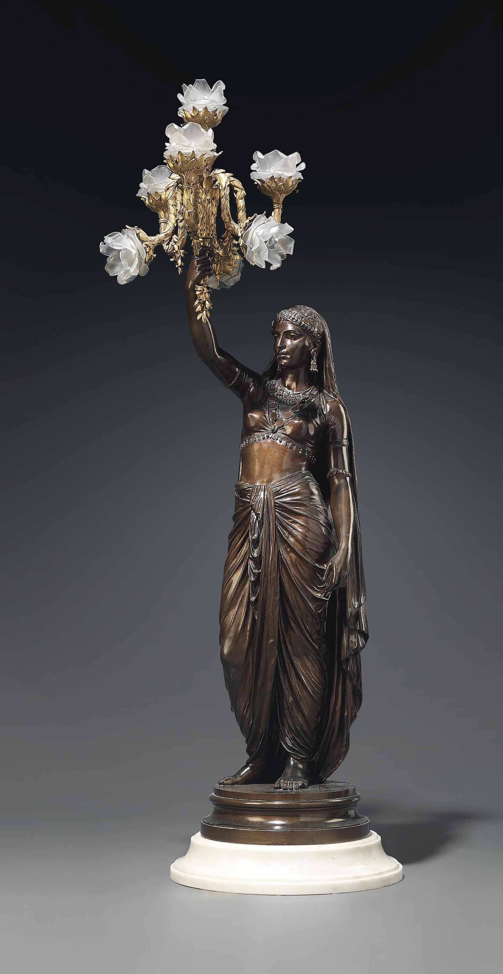 A FRENCH ORMOLU AND PATINATED BRONZE FIGURAL TORCHERE ENTITLED 'PERSANE'