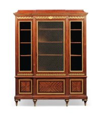 A FRENCH ORMOLU-MOUNTED MAHOGANY AND EBONY BREAKFRONT VITRINE-BIBLIOTHEQUE