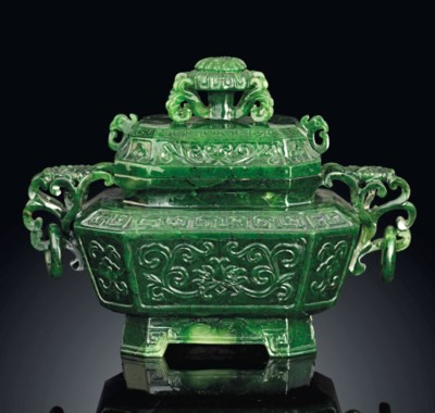A SPINACH-GREEN JADE TWIN-HAND