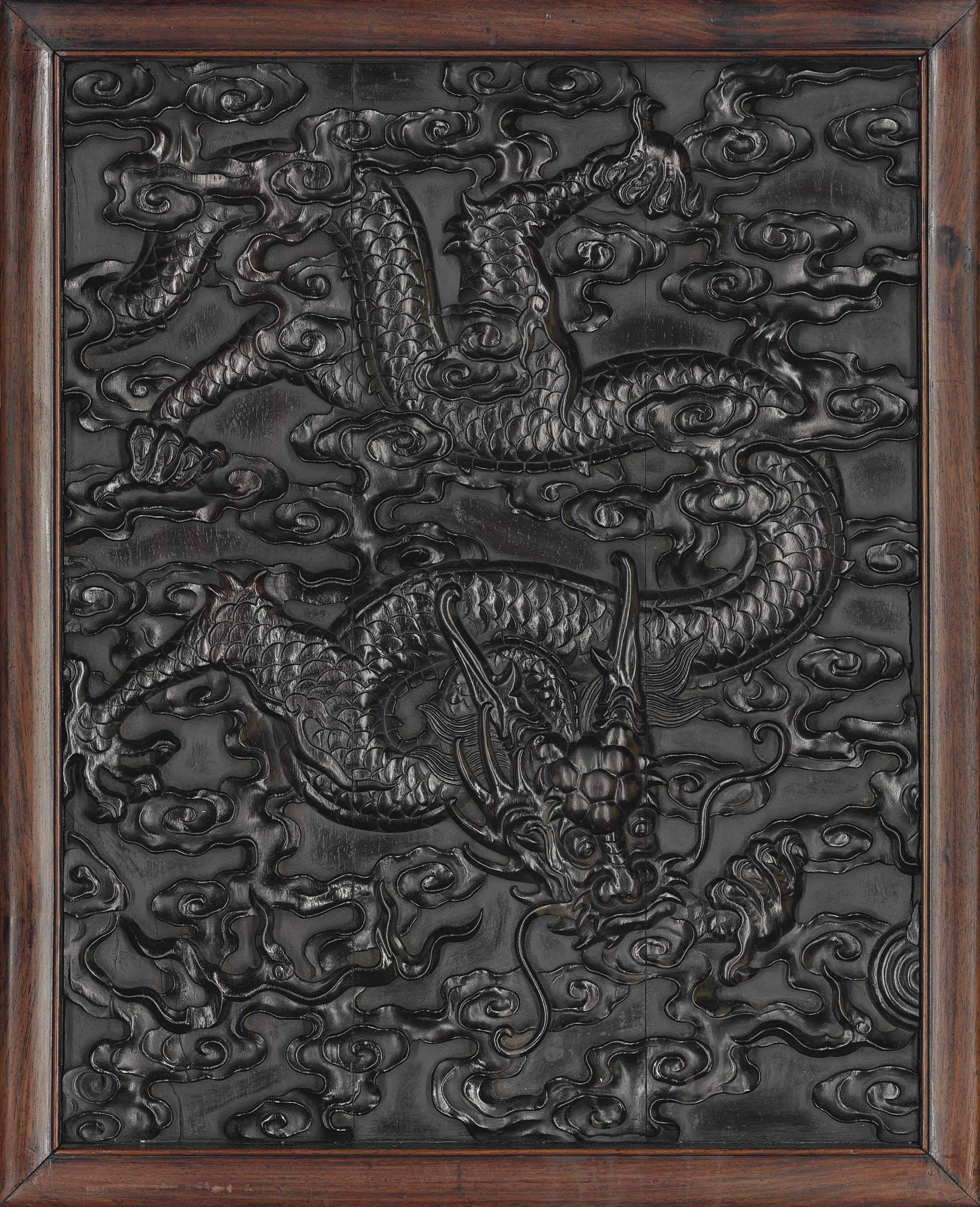 A CARVED ZITAN 'DRAGON' PANEL