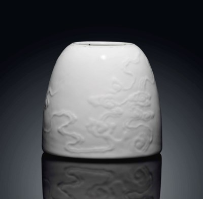 A CARVED WHITE GLAZED WATER PO