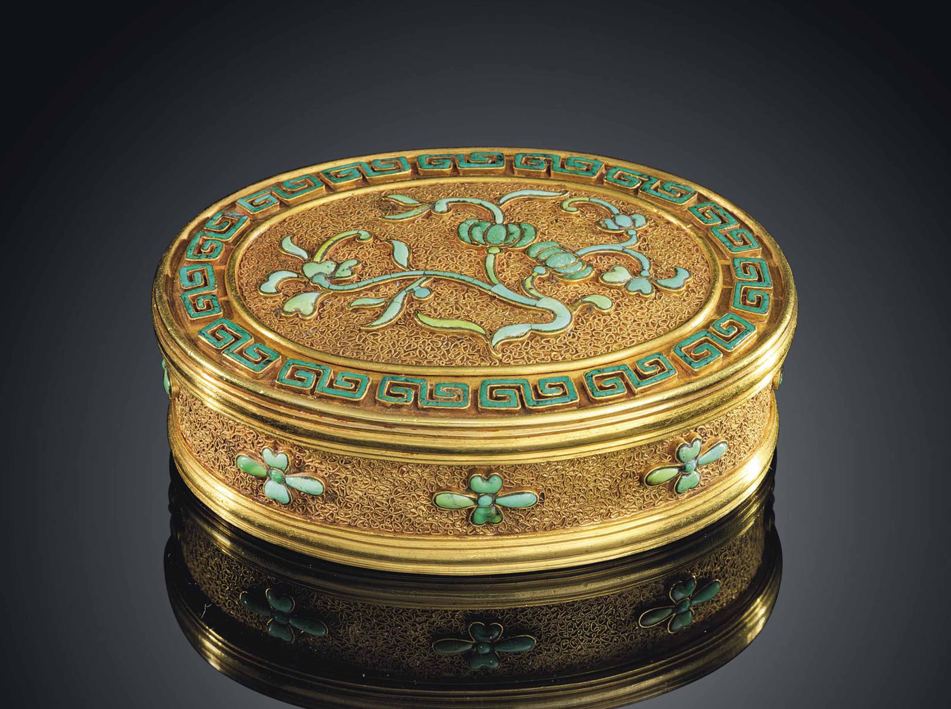 A SMALL TURQUOISE-INLAID GOLD
