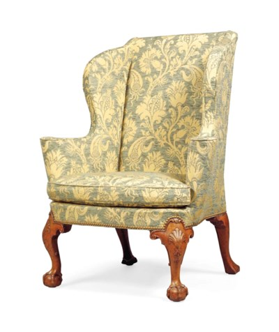 A GEORGE II WALNUT WING ARMCHA