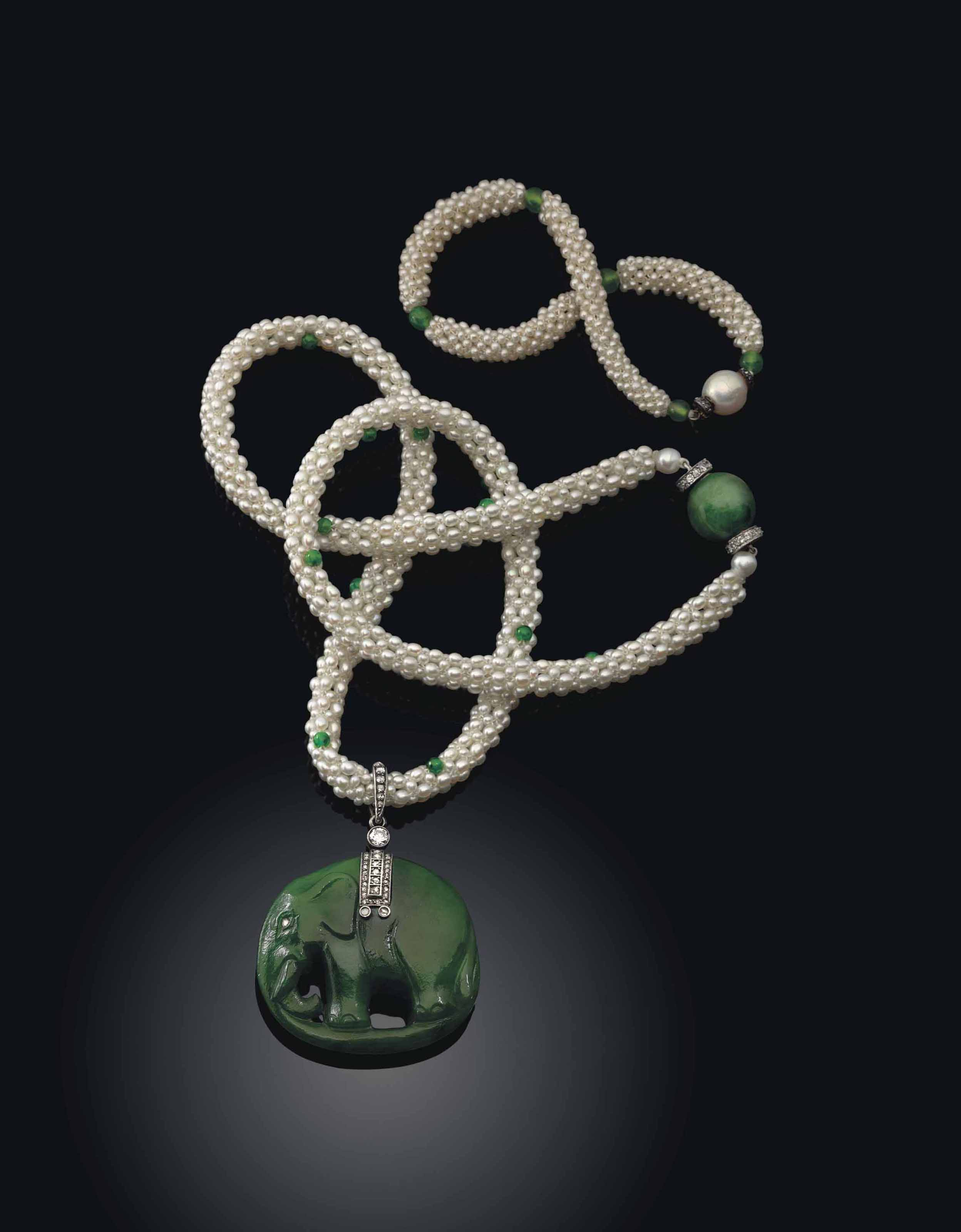 A JEWELLED SILVER AND PLATINUM-MOUNTED NEPHRITE PENDANT