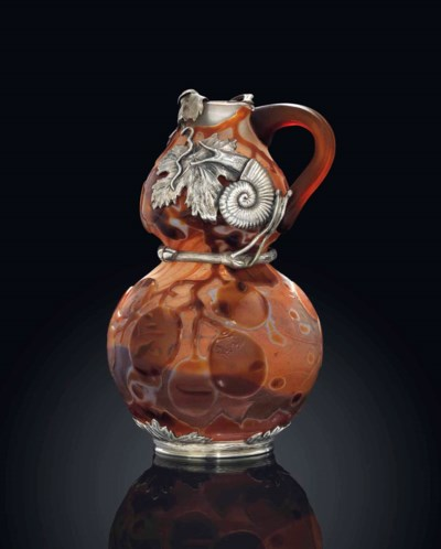 A SILVER-MOUNTED GLASS EWER