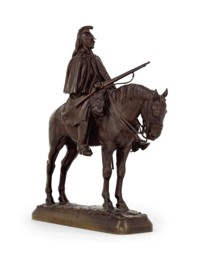 A BRONZE GROUP OF A CAVALRYMAN