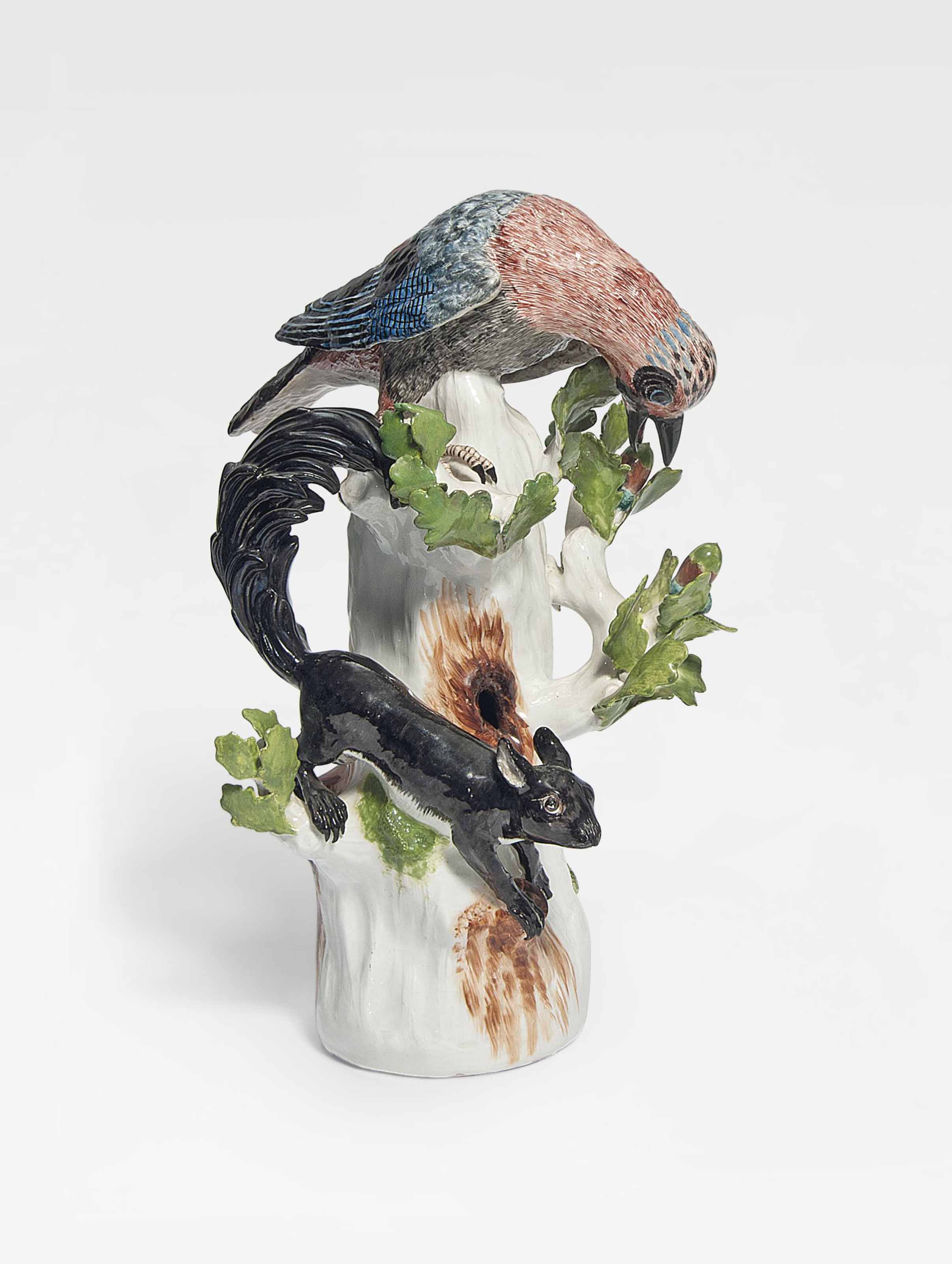 A MEISSEN MODEL OF A JAY WITH A SQUIRREL