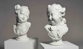 A PAIR OF NYMPHENBURG WHITE BUSTS OF CHILDREN