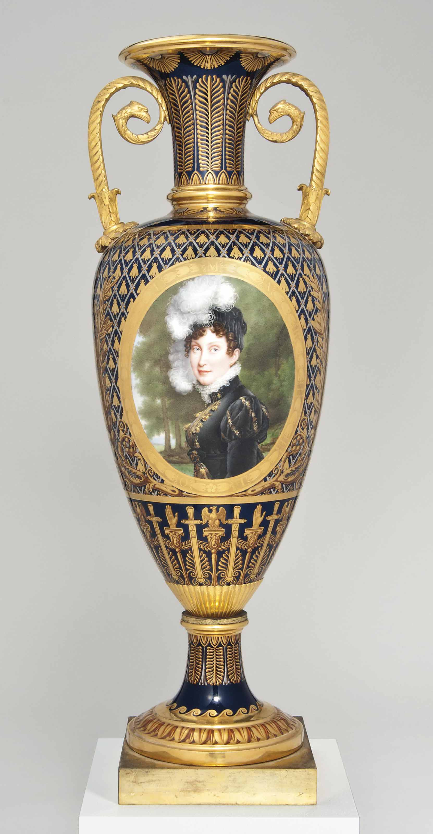 A SEVRES ORMOLU-MOUNTED BEAU BLEU-GROUND SLENDER OVIFORM TWO-HANDLED IMPERIAL PORTRAIT VASE (VASE 'FUSEAU', 2EME GRANDEUR)