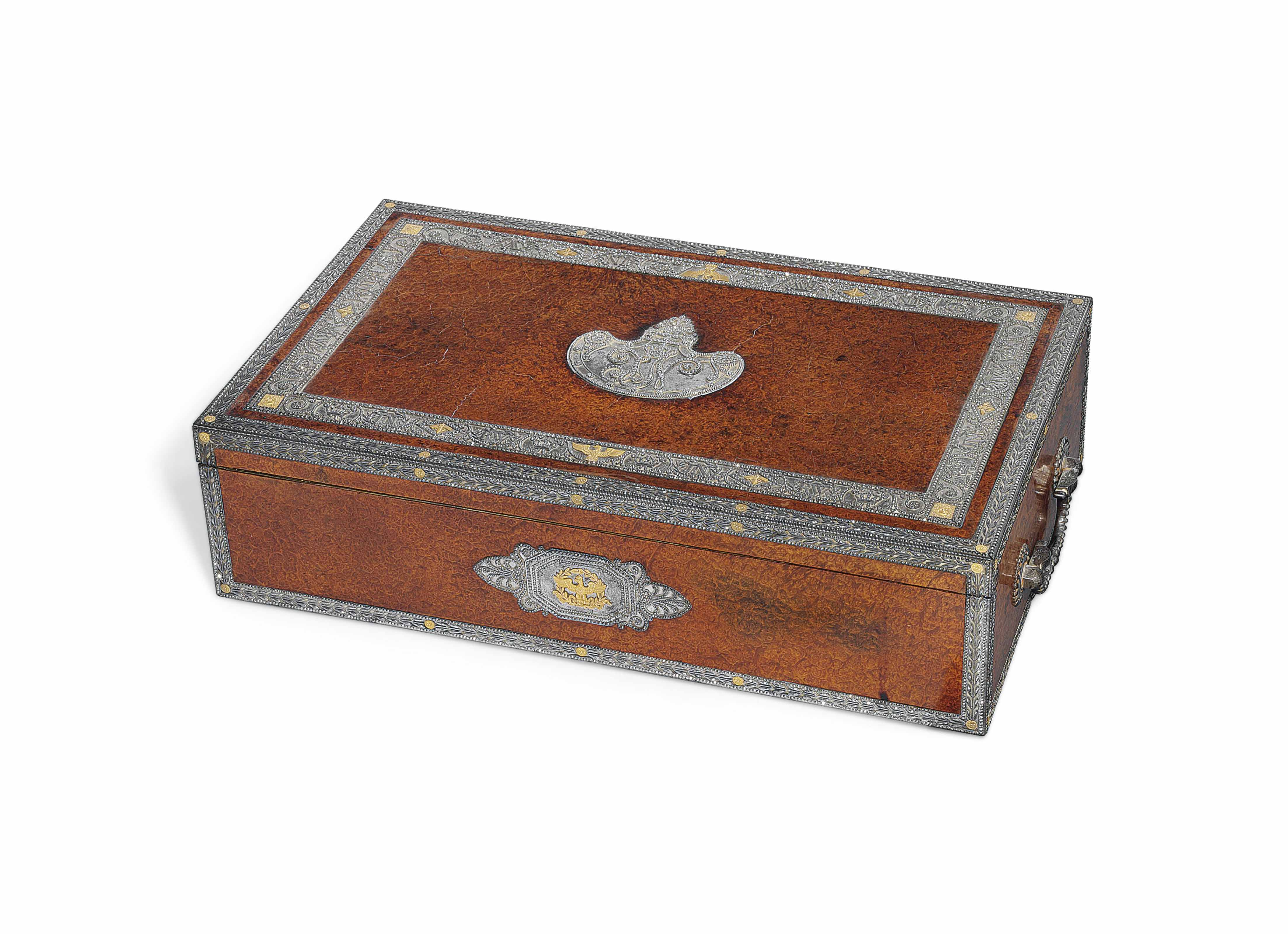 A FRENCH EMPIRE GOLD-MOUNTED, SILVER-GILT, GILT-BRONZE, MOTHER-OF-PEARL, POLISHED STEEL AND EBONY WRITING NECESSAIRE