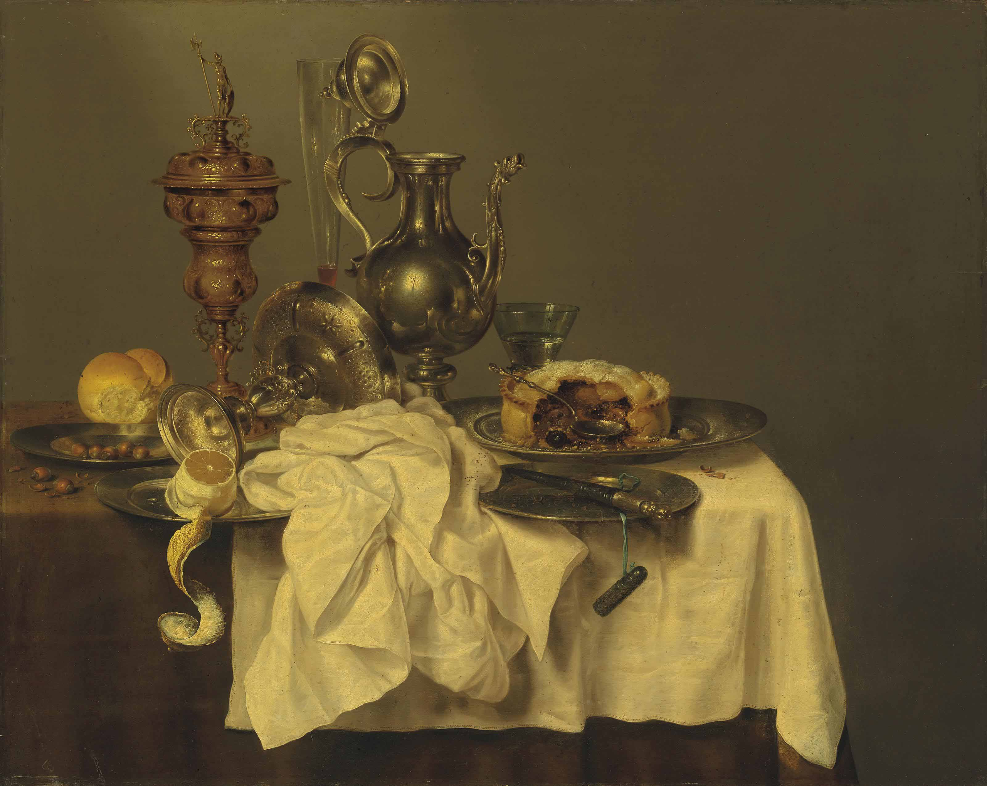 A blackberry pie on a pewter platter, a silver-gilded cup and cover, an upturned tazza, a partly-peeled lemon, a bread roll, hazelnuts, a façon-de-Venise glass, a silver decanter, a roemer, and a knife on a pewter platter, on a partly draped table