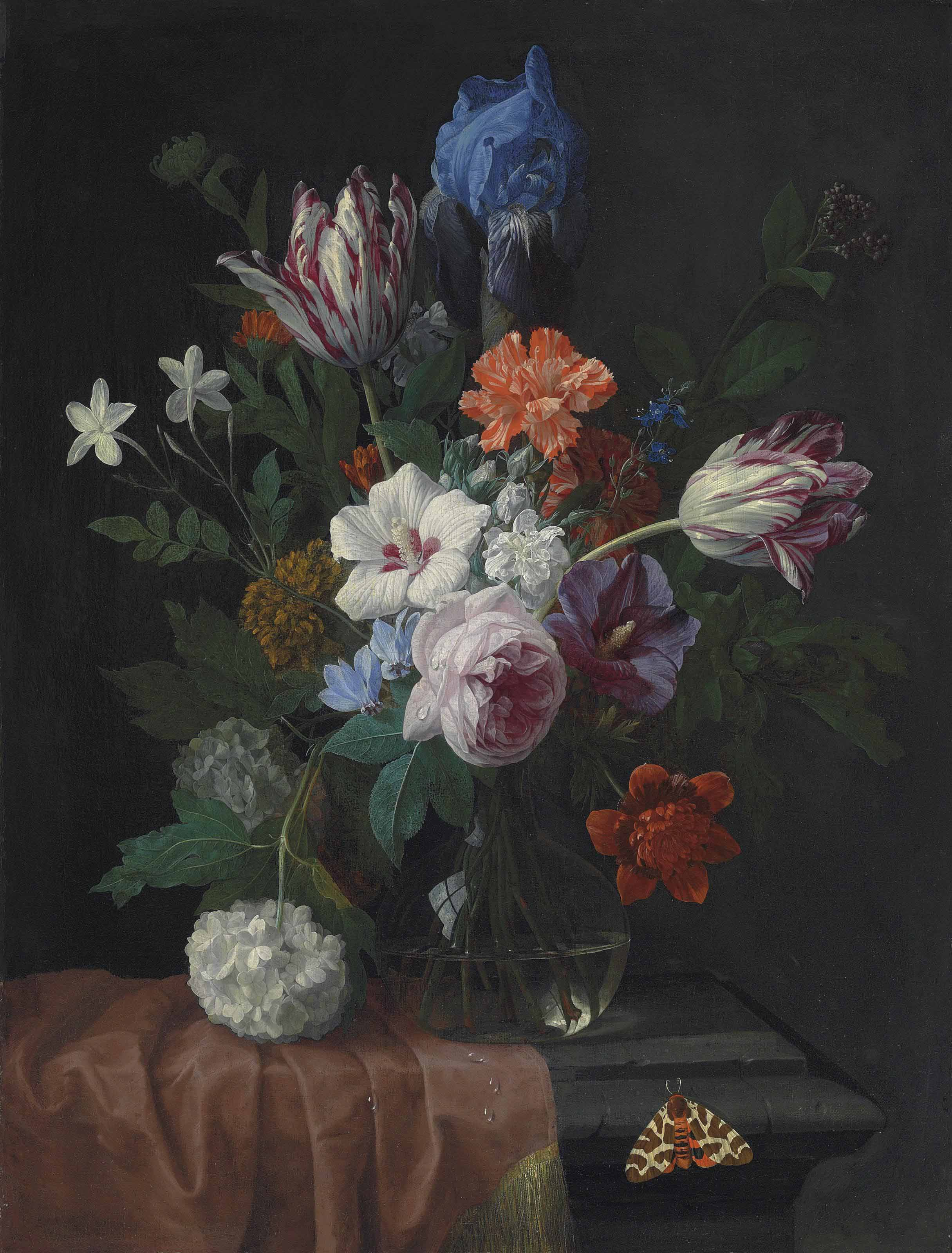 Hibiscus, parrot tulips, carnations, a rose, an iris, snowballs and other flowers in a vase on a partially draped stone ledge, with a garden tiger moth