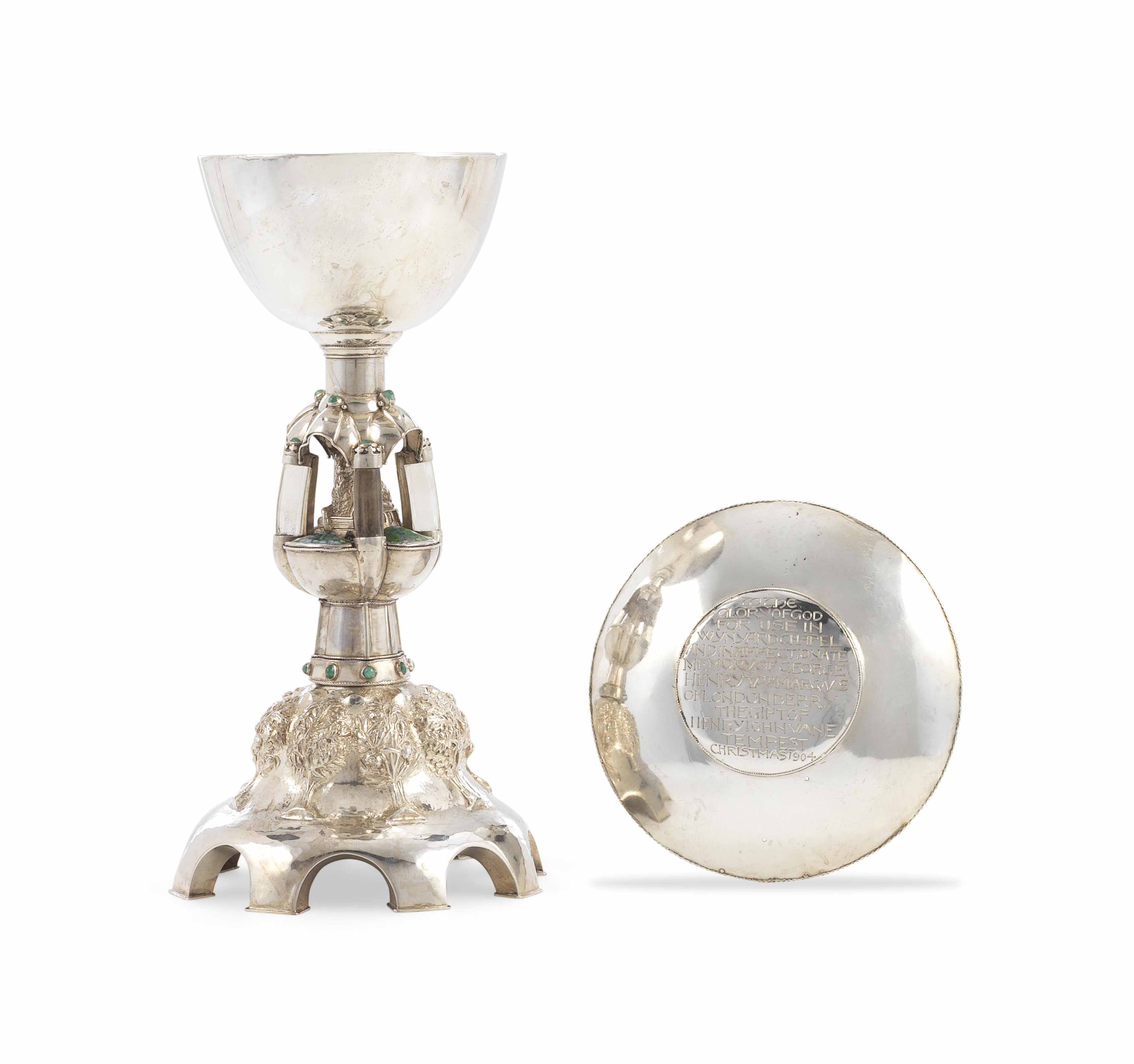 AN ARTS AND CRAFTS HARDSTONE-MOUNTED ENAMELLED SILVER CHALICE AND PATEN
