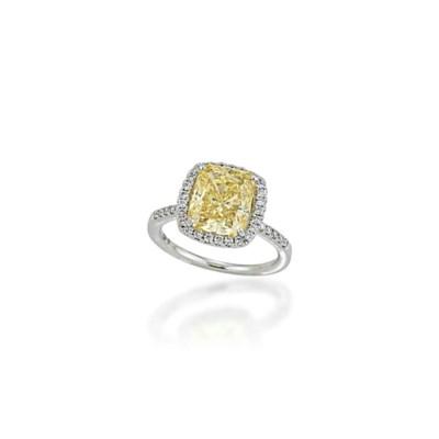 A YELLOW DIAMOND RING