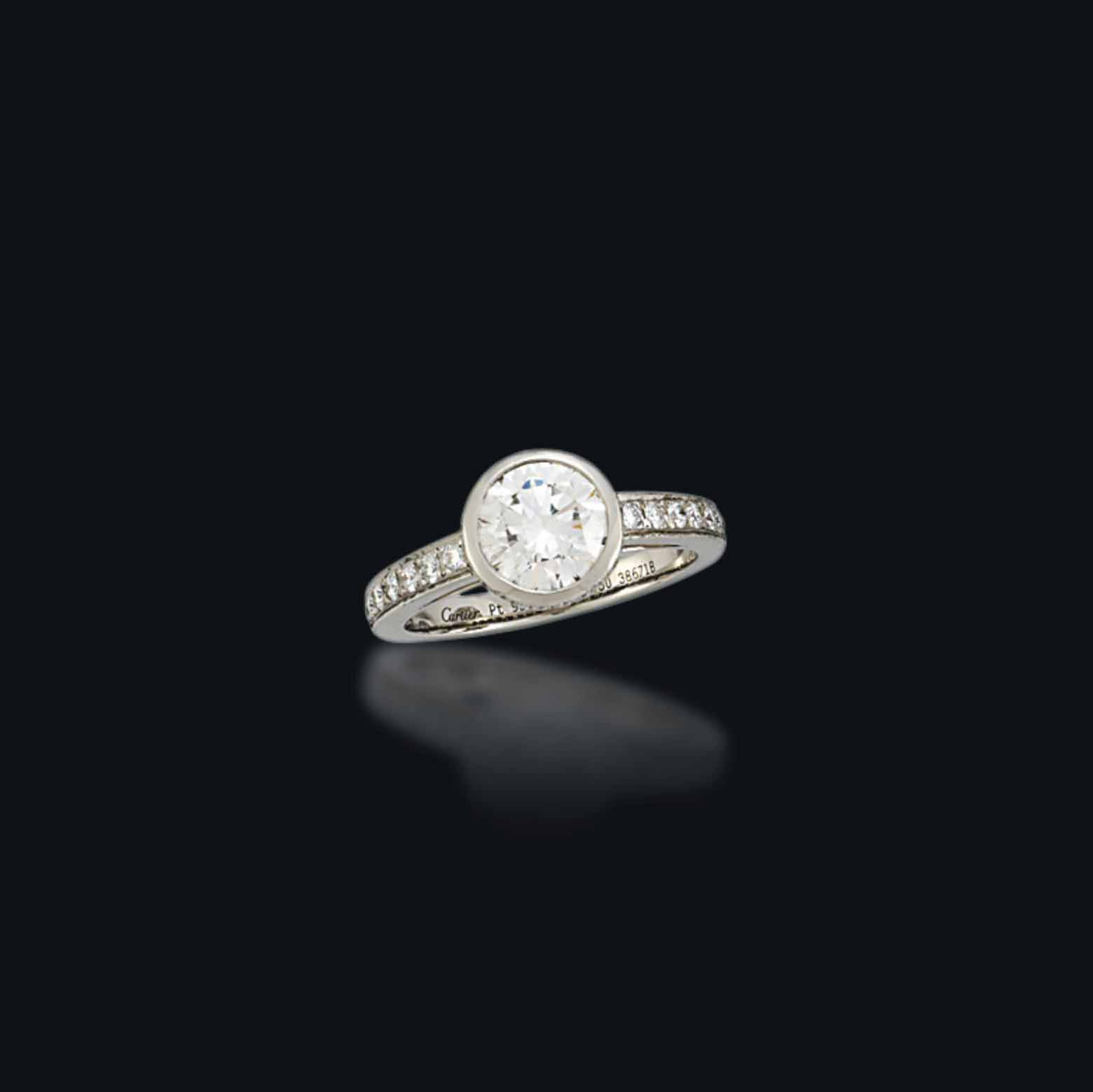 A DIAMOND RING, BY CARTIER