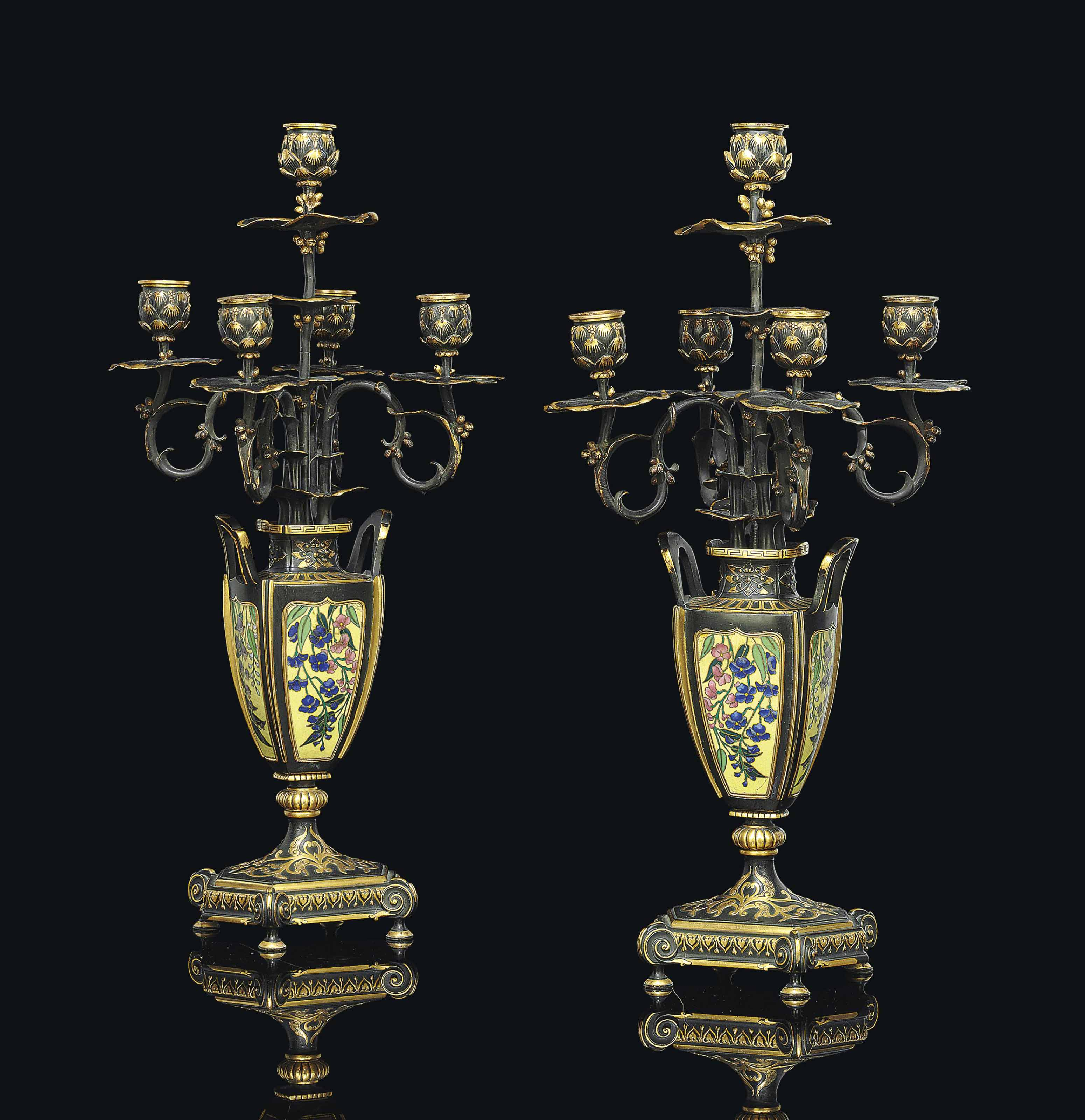 A PAIR OF FRENCH 'JAPONISME' GILT AND PATINATED BRONZE AND ENAMEL FIVE-LIGHT CANDELABRA