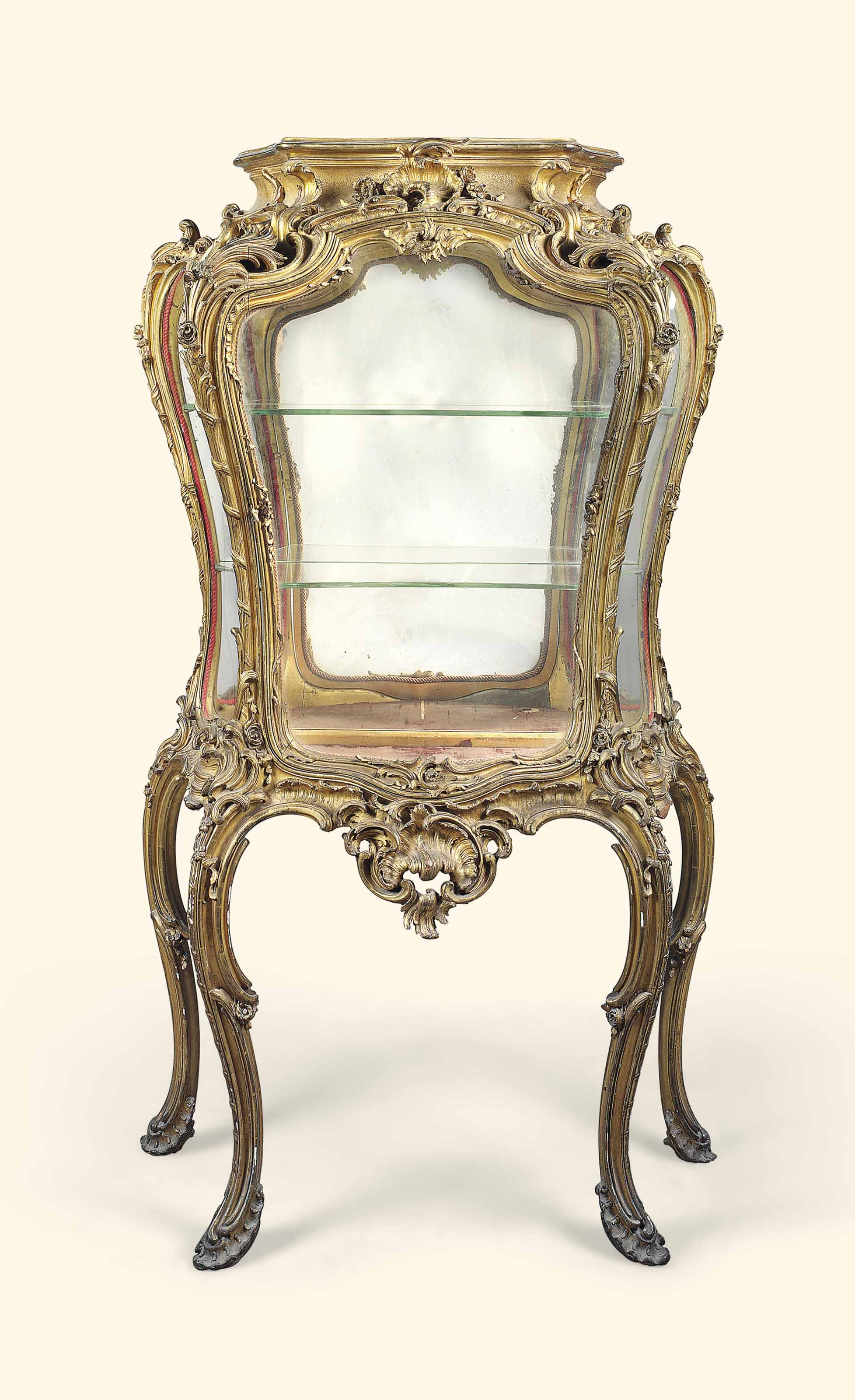 A FRENCH CARVED GILTWOOD VITRINE-ON-STAND