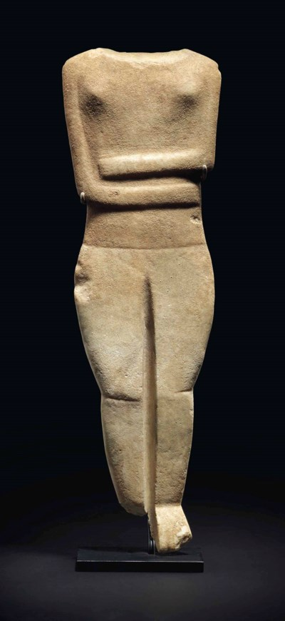 A LARGE CYCLADIC MARBLE RECLIN