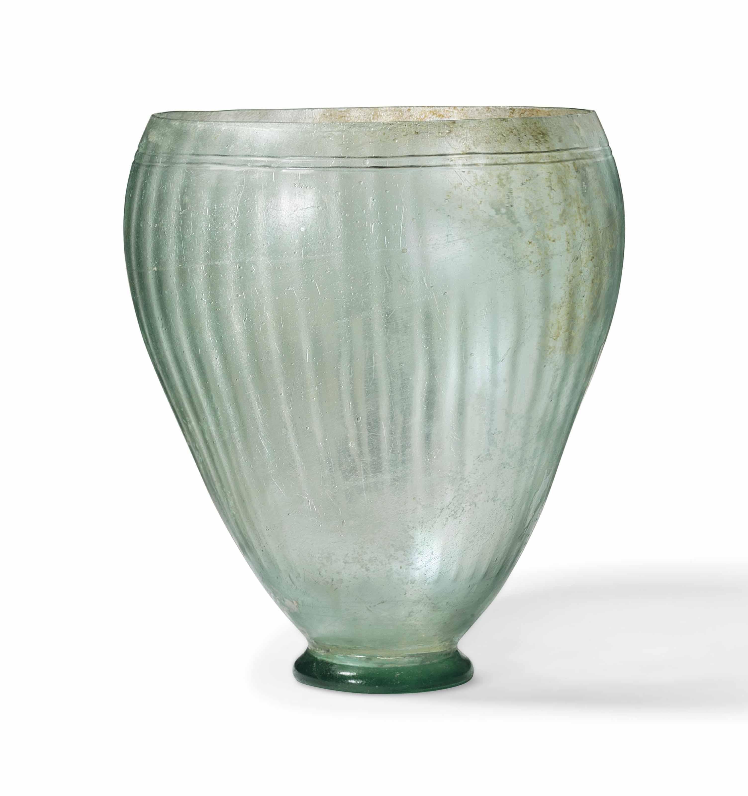A ROMAN PALE GREEN GLASS GOBLET