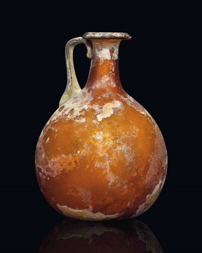 A ROMAN AMBER GLASS FLASK