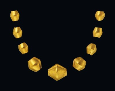 NINE WESTERN ASIATIC GOLD BEAD