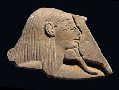 AN EGYPTIAN PAINTED SANDSTONE