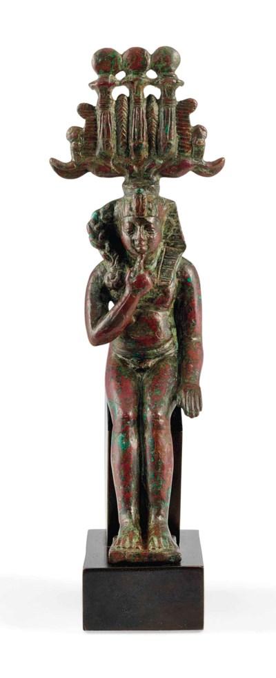 AN EGYPTIAN BRONZE HARPOCRATES