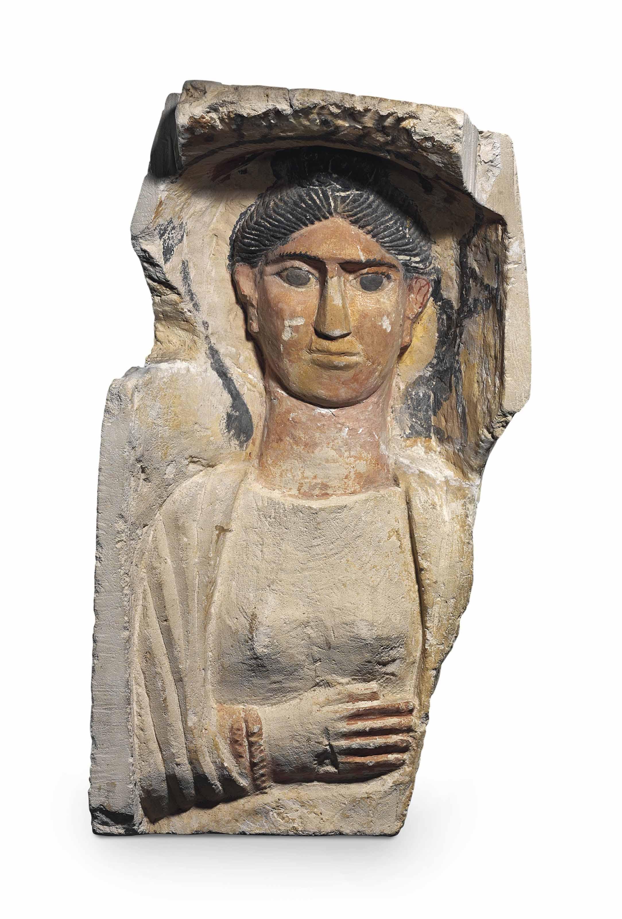 AN EGYPTIAN PAINTED LIMESTONE STELE