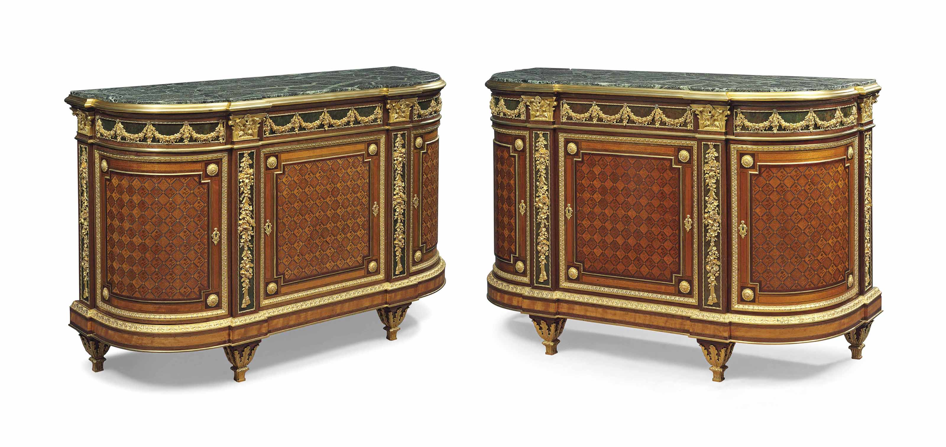 A PAIR OF FRENCH ORMOLU-MOUNTED AMARANTH, MAHOGANY, BOIS SATINÉ, GREEN-STAINED WALNUT AND PARQUETRY SIDE-CABINETS