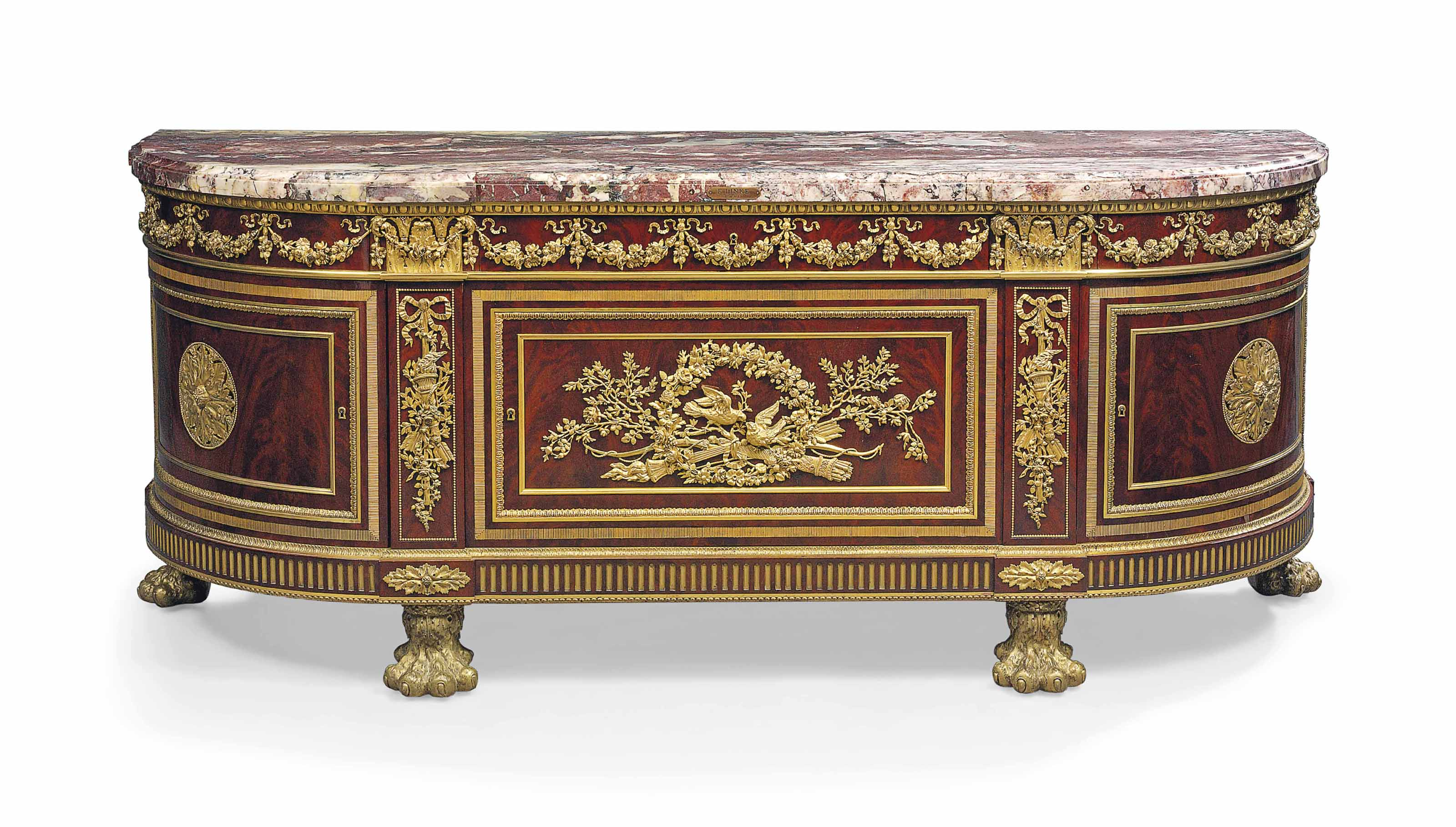 A FRENCH ORMOLU-MOUNTED MAHOGANY COMMODE