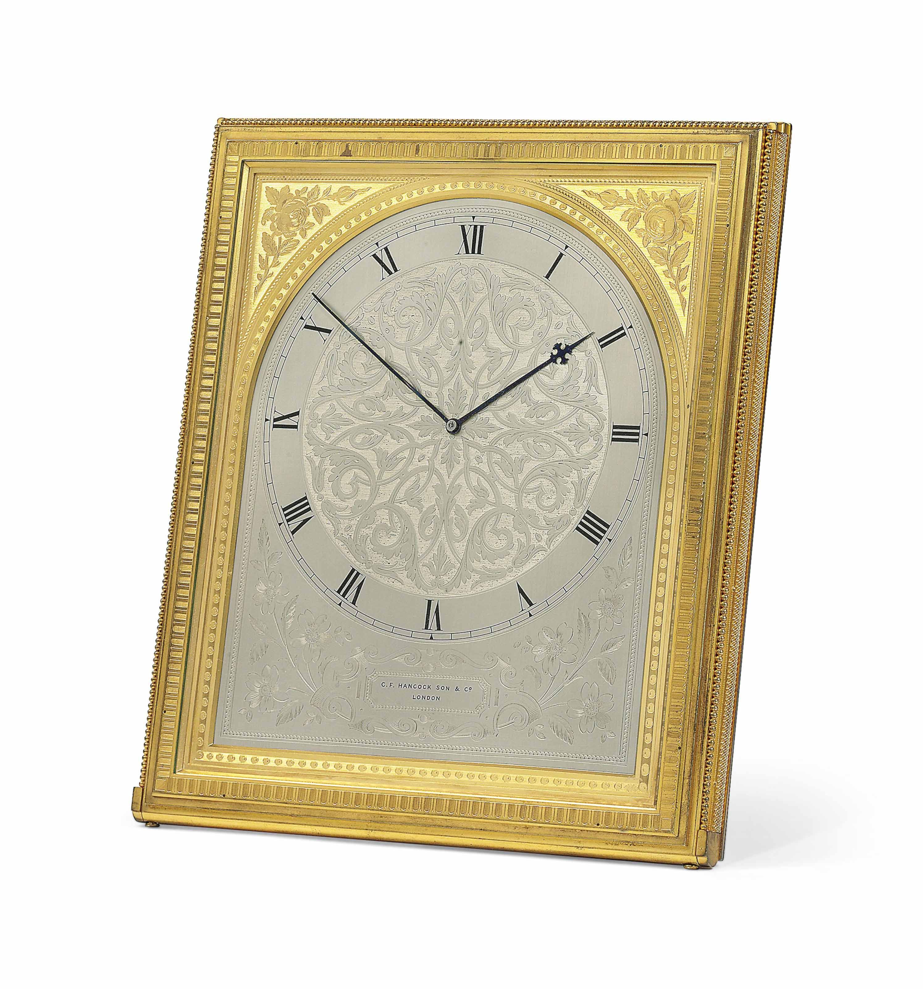 A VICTORIAN GILT-BRASS TIMEPIECE STRUT CLOCK