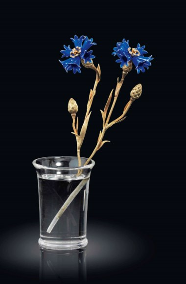A jewelled and guilloché enamel gold-mounted rock crystal study of cornflower marked Fabergé, circa 1900. 6⅝  in (17  cm) high. Sold for £314,500 on 24 November 2014 at Christie's in London