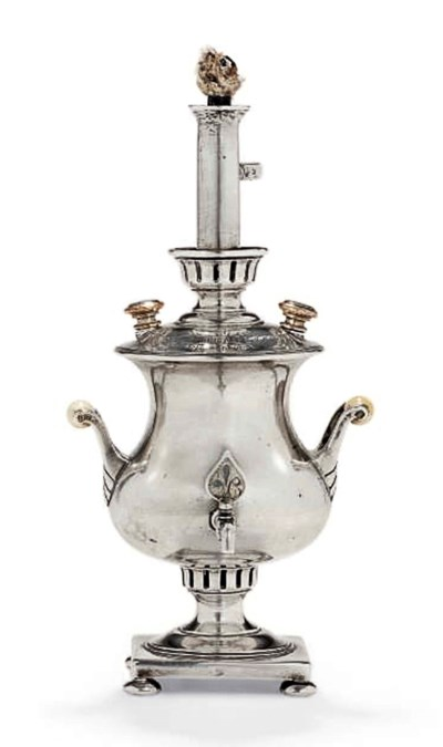 A SILVER TABLE LIGHTER IN THE