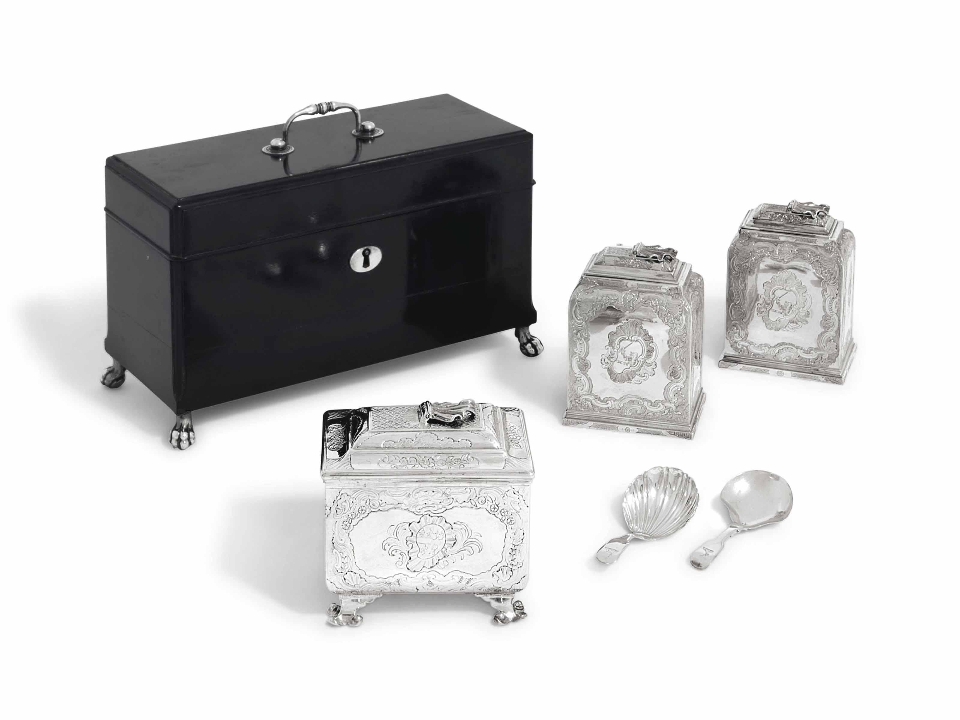 A PAIR OF GEORGE II SILVER TEA-CADDIES AND A SUGAR-BOX EN SUITE