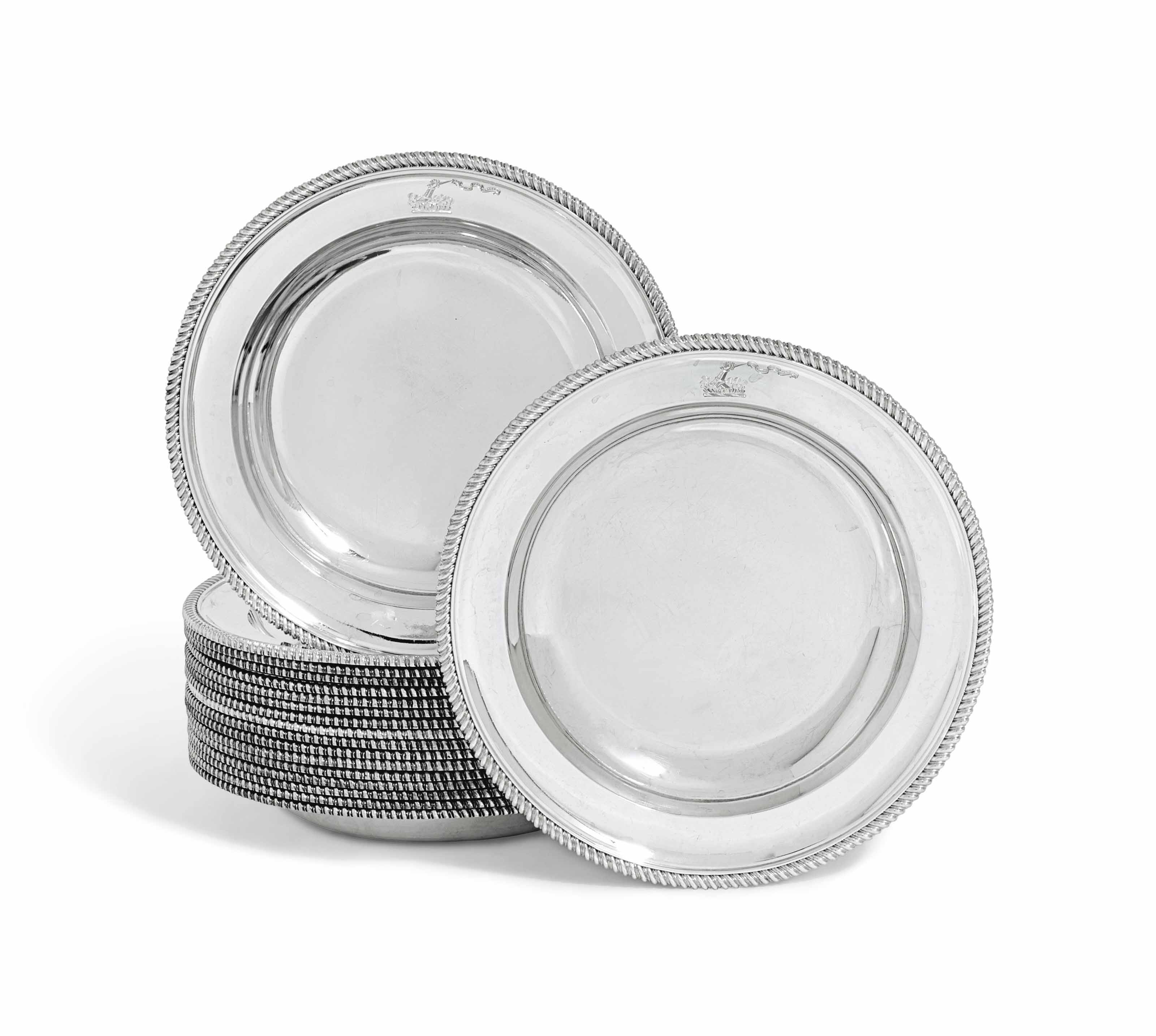 A SET OF EIGHTEEN GEORGE IV SILVER SOUP-PLATES