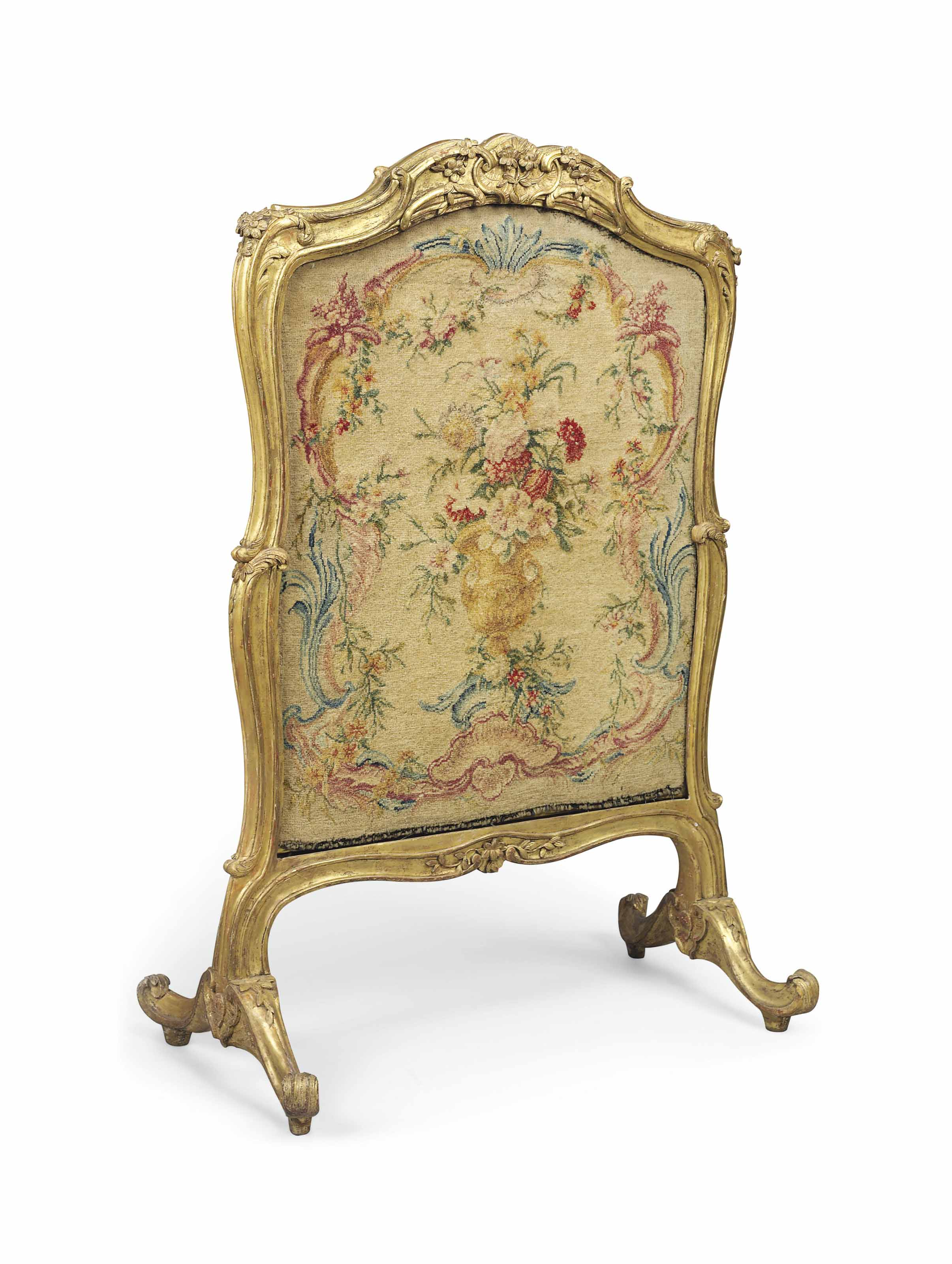 A LOUIS XV GILTWOOD FIRESCREEN INSET WITH A SAVONNERIE PANEL