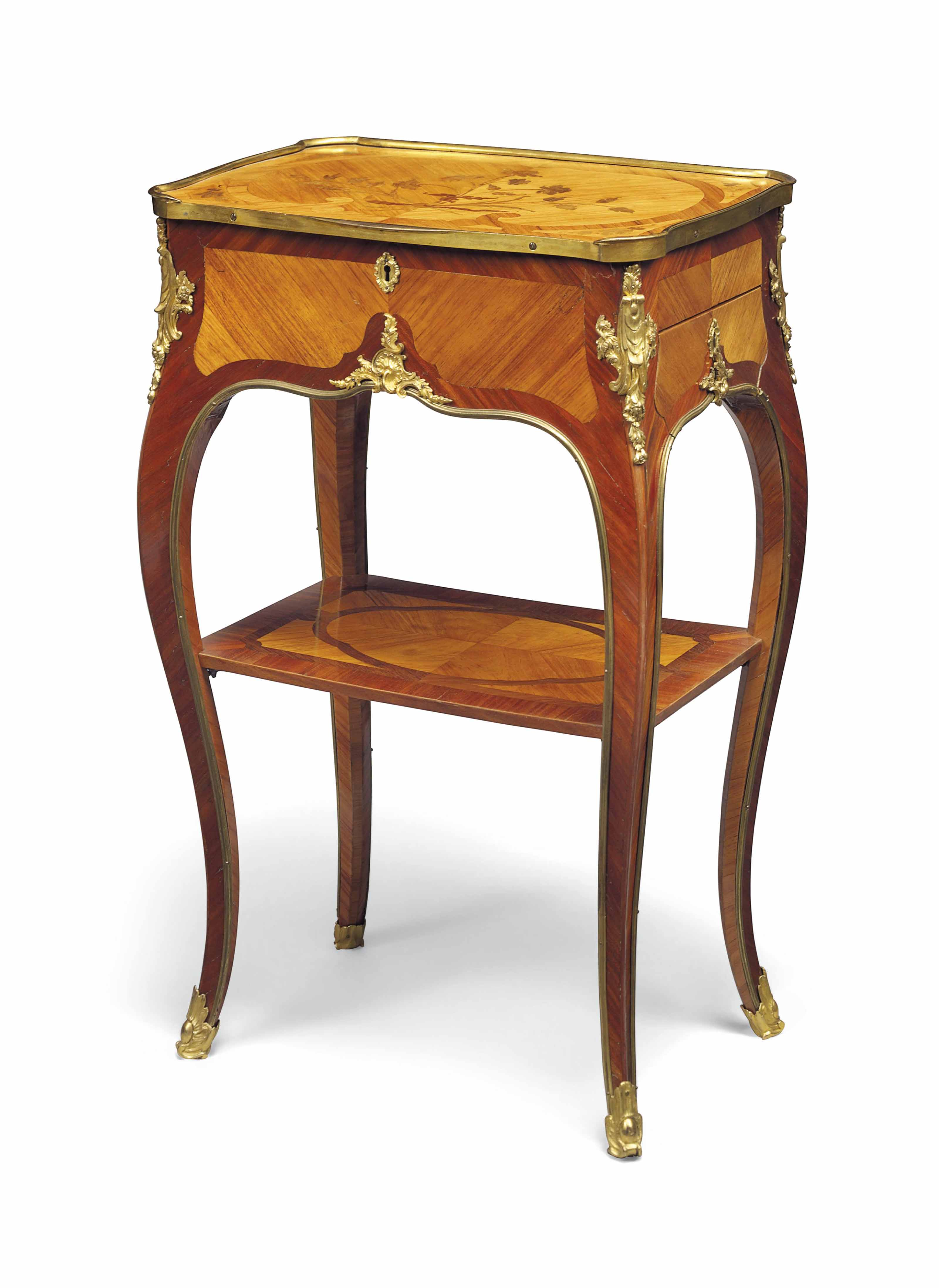 A LOUIS XV ORMOLU-MOUNTED TULIPWOOD, BOIS SATINE, AMARANTH AND BOIS-DE-BOUT MARQUETRY TABLE EN CHIFFONNIERE