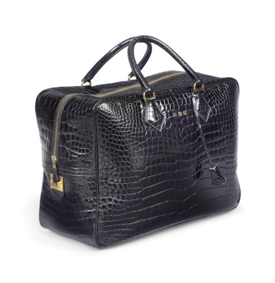 A BLACK CROCODILE PLUME BAG