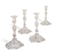 A SET OF FOUR WILLIAM IV SILVER CANDLESTICKS