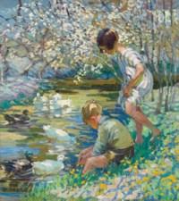 Children playing beside a stream